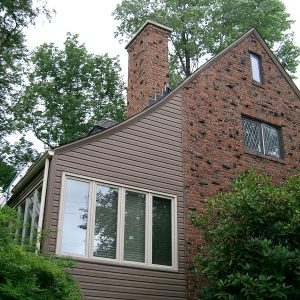 House with shingles, brick and window