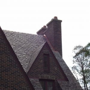 Wood siding on house with double chimney