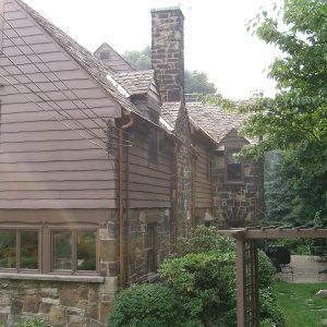Wood and stone house with back porch