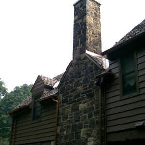 Stone chimney on house